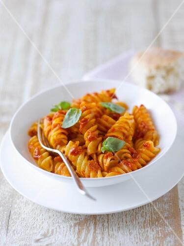 Tomato Gemelli Pasta in a Bowl Bowl; Bread