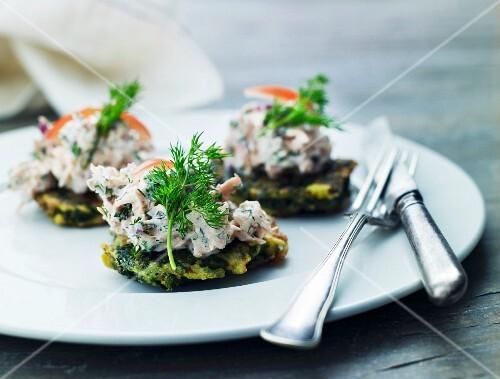 Potato cakes topped with tuna salad