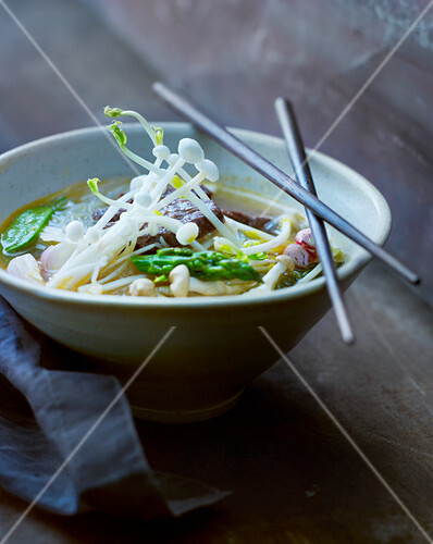 Asian vegetables soup with enokitake mushrooms