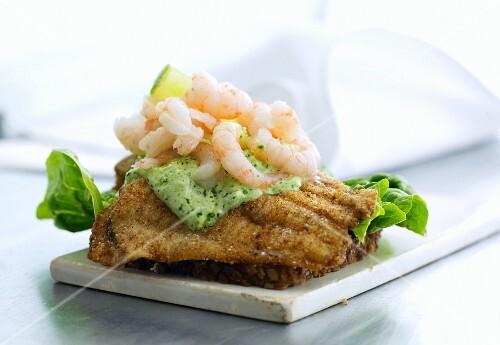 Smörrebröd with fried fish, herb sauce and North Sea shrimps (Denmark)