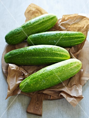 Four cucumbers on a piece of paper