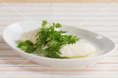 Poached fish dumpling with fresh herbs