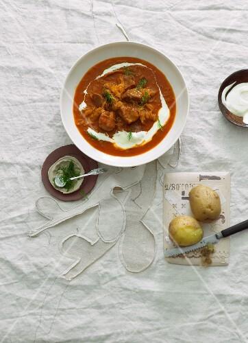 Hungarian goulash with sauerkraut and sour cream