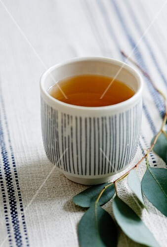 Green tea in a stripy bowl