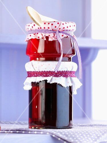 Two types of berry jelly one on top of each other