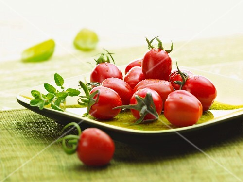 A plate of fresh tomatoes