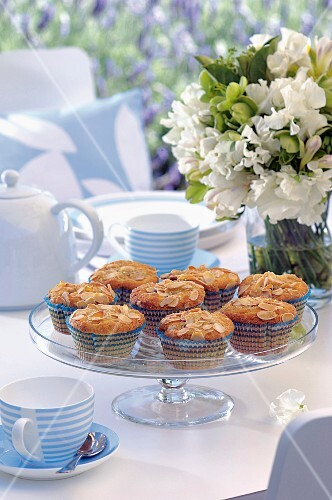 Almond and raspberry muffins on a coffee table