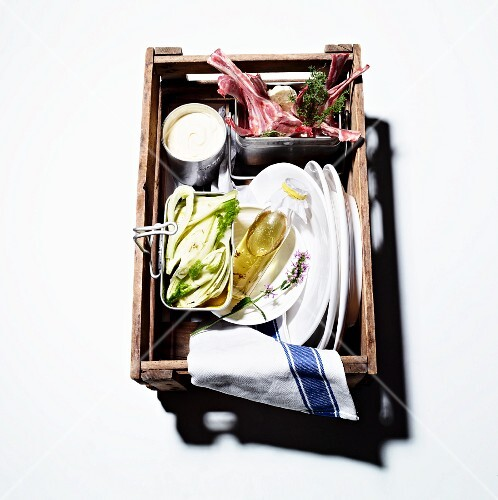 A picnic basket for a barbecue: lamb chops, raw fennel and marinade