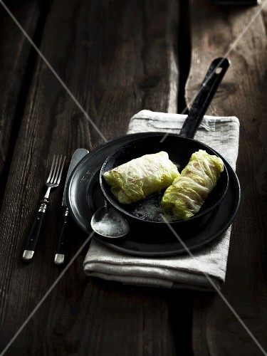 Chinese cabbage roulade with a mushroom filling a rashers of bacon