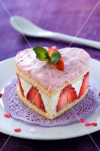 A heart-shaped strawberry cake