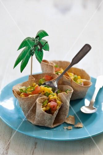 Corn salad in taco shells