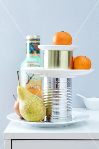 Fruit on a simple cake stand made of plates and tin cans