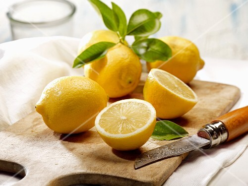 Lemons with leaves and a knife