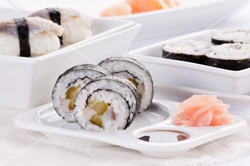 Maki and nigiri sushi with herring and gherkins