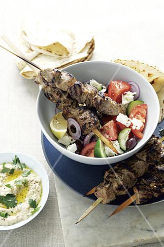 Marinated lamb kebabs on a farmhouse salad (Greece)