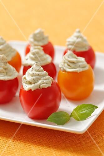 Cherry tomatoes filled with feta-pesto cream