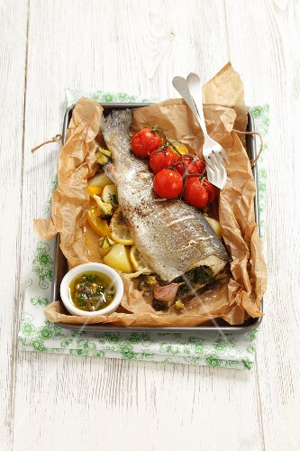 Trout with vegetables and caper sauce in foil