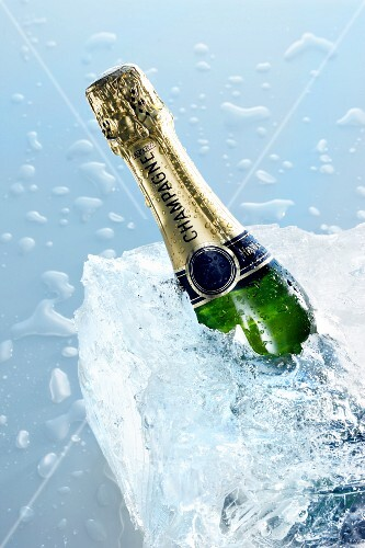 A bottle of champagnes in a block of ice