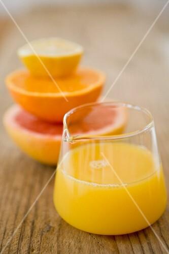 Citrus fruit juice in a glass jug