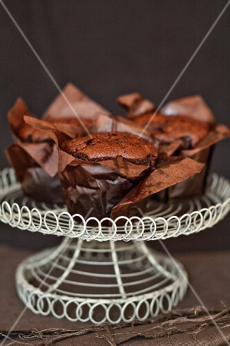 Chocolate muffins on a cake stand