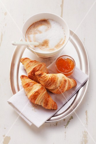 Croissant with marmalade and cafe au lait