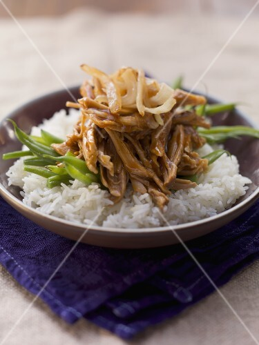Pulled pork and onions on a bed of rice