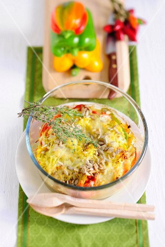 Pepper and potato gratin with thyme and sunflower seeds