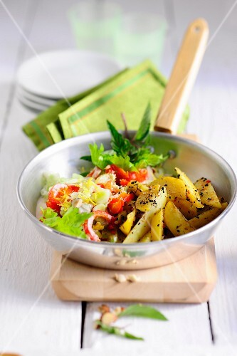 Fried potatoes with peppers and celery