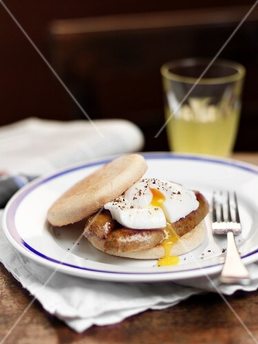 English muffin with sausage and poached egg