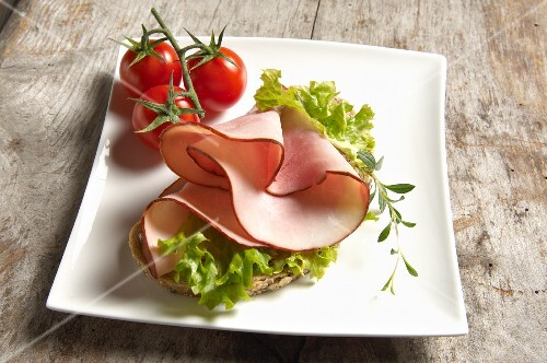 Open face sandwich with turkey ham and Lollo Bianco, thyme and cherry tomatoes