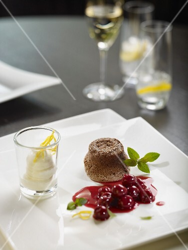 Chocolate souffle with cherry ragout and yogurt ice cream