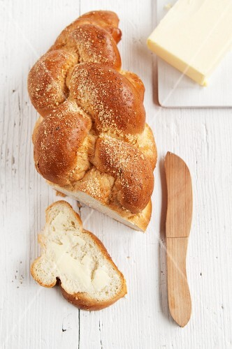 Challah (braided yeast bread) with butter