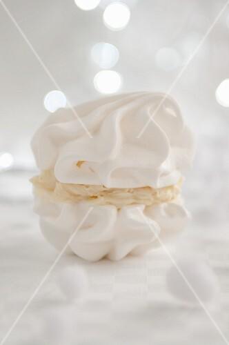 White meringue cookies with coconut cream