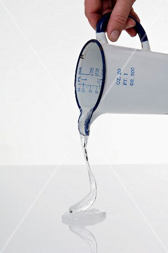 Glucose syrup being poured from a measuring jug