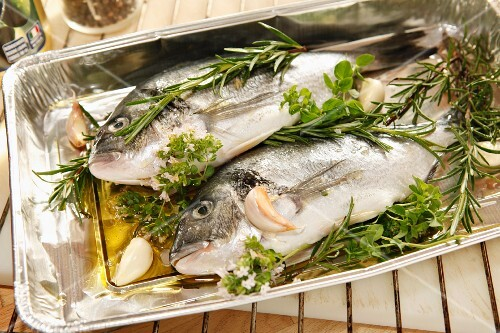 Bream with herbs, garlic and olive oil (ready to roast)