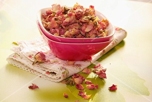 A bowl of dried rose petals