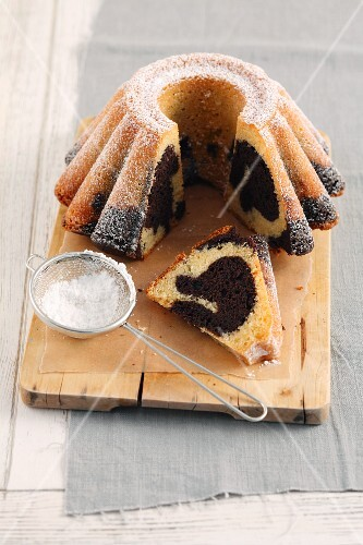 Baba marble cake with icing sugar