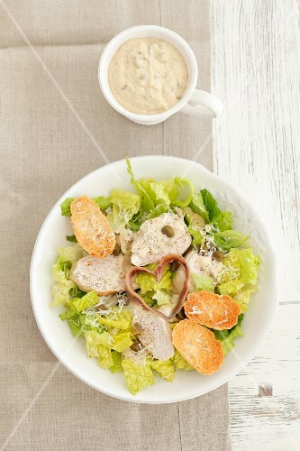 Caesar salad with chicken and anchovy hearts
