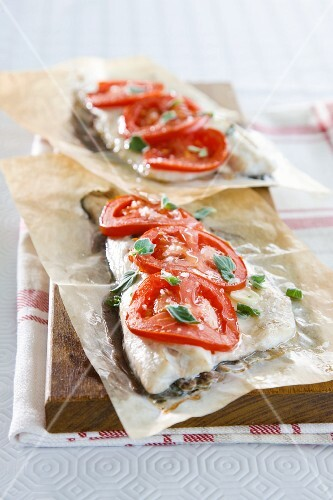 Oven-baked fish fillet with tomatoes and oregano