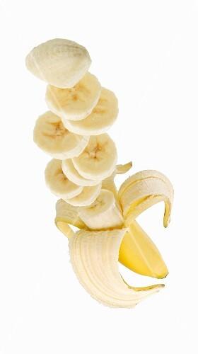 A banana, partially sliced