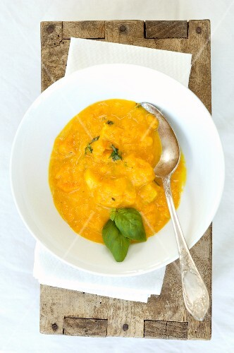 Pumpkin soup with basil (seen from above)
