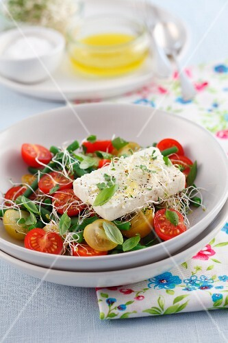 Cherry tomato salad with green beans, alfalfa sprouts and feta cheese
