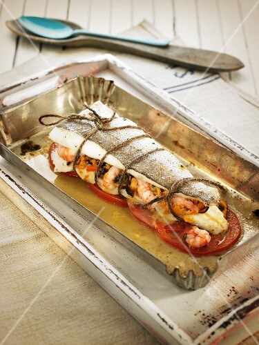 Baked hake filled with seafood (Spain)