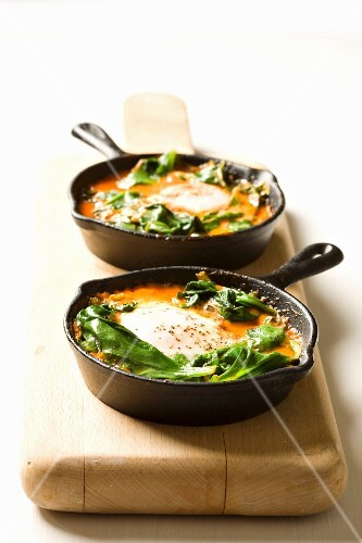 Shakshouka - poached eggs with tomatoes and spinach, Israel