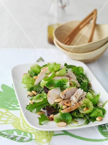 Brussels sprouts salad with chicken and pine nuts