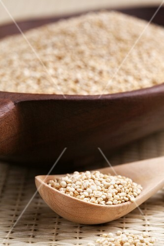 Quinoa on a wooden spoon