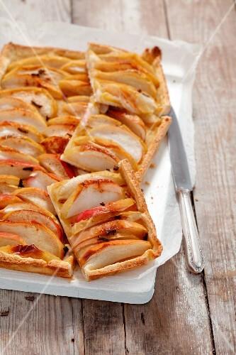 An apple and cinnamon tart, sliced