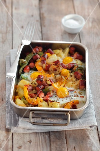 Sausage bake with potatoes, peppers, onions and egg