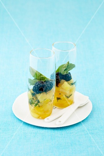 Pineapple compote with mulberries and mint
