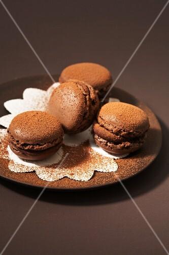 Four chocolate macarons